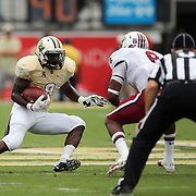 UCF Knights running back Storm Johnson (8) runs during an NCAA football game between the South Carolina Gamecocks and the Central Florida Knights at Bright House Networks Stadium on Saturday, September 28, 2013 in Orlando, Florida. (AP Photo/Alex Menendez)