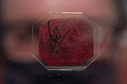 © Licensed to London News Pictures. 28/04/2021. LONDON, UK.  A staff member presents the legendary 1856 British Guiana One-Cent Magenta stamp (Est. $10–15m at Sotheby's New Bond Street.  The sole survivor of its kind, it was created as a contingency when a shortage of stamps usually imported from England threatened to disrupt the postal service throughout British Guiana. Each of the four times it has sold at auction, it has established a new record price for a single stamp and will be part of the auction collection of high-end shoe designer Stuart Weitzman at Sotheby's New York on 8 June.  Photo credit: Stephen Chung/LNP