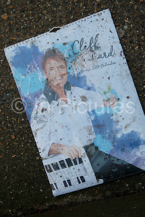 Discarded Sir Cliff Richard calendar in London, England, United Kingdom. Sir Cliff Richard OBE is a British pop singer, musician, performer, actor and philanthropist. Richard has sold more than 250 million records worldwide.