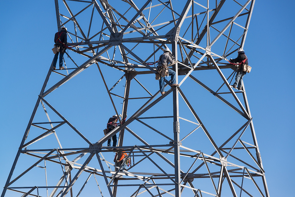 Construction crew assembling electricity transmission tower in Utah.