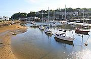 Yachts in harbour marina low tide, Porthmadog, Gwynedd, north west Wales, UK