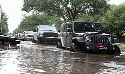 August 29, 2017 - Houston, Texas, U.S. - Jeeps and trucks wait in line to assist in rescue operations of Katy Grande Lakes residents due to flooding from Hurricane Harvey. (Credit Image: © John Glaser/CSM via ZUMA Wire)