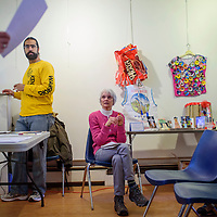 Linda Popelish, center, sits near some example pieces as Popelish, Shafiq Chaudhary and other members of the McKinley Citizens' Recycling Council conduct a workshop for their upcoming Trashion Show. The show, a fashion show featuring garments made of recycled materials, will be hosted at the Rio West Mall on April 15.