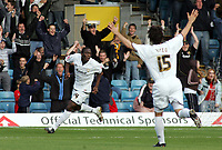 Photo: Paul Thomas.<br /> MK Dons v Swindon Town. Coca Cola League 1.<br /> 01/10/2005.<br /> <br /> MK Dons player Nicky Rizzo and fans celebrates number 14 Malvin Camara's goal.