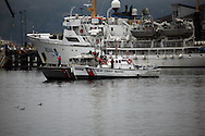 Coast Guard Boats next to NOAA ships look small.