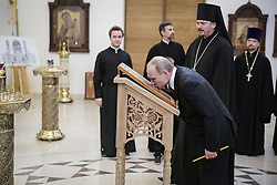 May 29, 2017 - Paris, FRANCE - Russian President Vladimir Putin kisses an icon representing the Saint Trinity as he visits the new Russian orthodox church, the Saint Trinity church, located on the banks of the Seine river in Paris, France, while the representative of the Patriarchy of Moscow in Paris, Bishop Nestor, looks on, Monday, May 29, 2017. (Credit Image: © Prensa Internacional via ZUMA Wire)