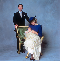 THREE-MONTH-OLD PRINCE HENRY OF WALES,<br /> THE YOUNGER SON OF THE PRINCE AND<br /> PRINCESS OF WALES AFTER HIS CHRISTENING<br /> IN ST GEORGE'S CHAPEL, WINDSOR, WITH<br /> HIS PARENTS IN CHRISTENING GOWN.