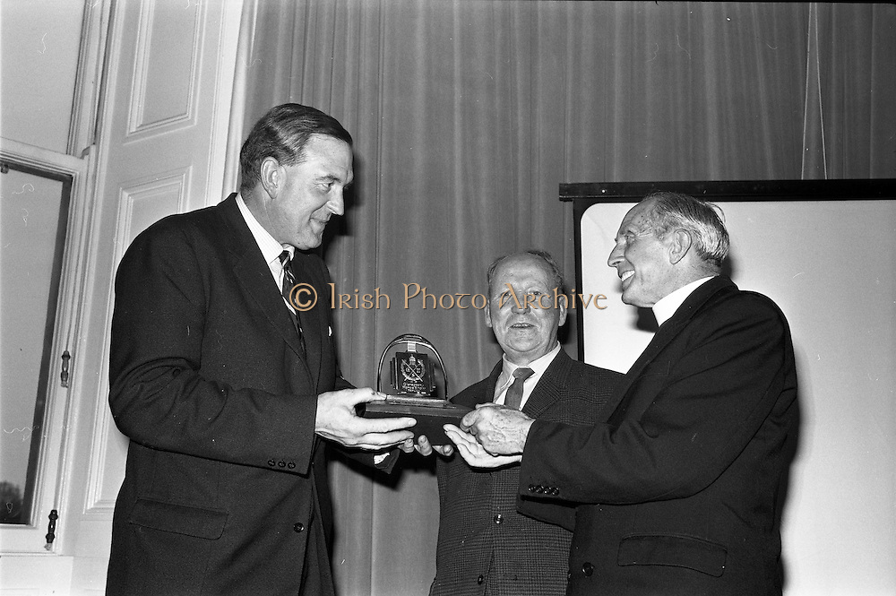 01/07/1963<br /> 07/01/1963<br /> 01 July 1963<br /> W.D. & H.O. Wills LTD., handing over trophy to Glenageary Horse Show Committee at the Royal Marine Hotel, Dun Laoghaire. A prize fund cheque of £300  and silver trophy for the winner of the Gold Flake Stakes were presented to the committee. Picture shows: Mr D.R. Mott, General Manager W.D. & H.O. Wills Ltd., handing over the prizes to Very Rev. Fr Lucey, P.P. Glasthule. Centre is Mr J. McElroy, Vice Chair, Horse Committee.