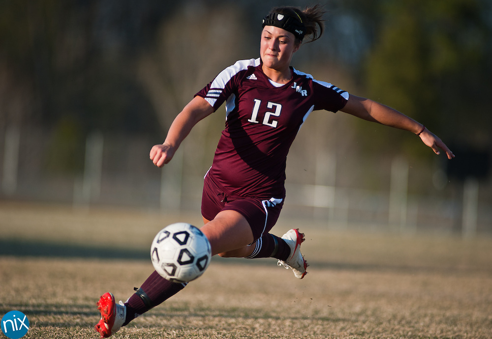 Jay M. Robinson's Hanna Cacace moves the ball downfield against Cox Mill Tuesday afternoon at Cox Mill High School in Concord. Robinson held off the Chargers 2-1.  (Photo by James Nix)