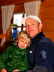 Jesper Radich relaxes with his son Bertrand after qualifying day 4.Photo:Chris Davies/WMRT