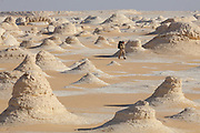 Sam McConnell walks amongst the chalk rock formations of the Sahara Beida (White Desert), Egypt