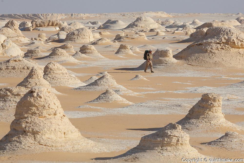Sam McConnell walks amongst the chalk rock formations of the Sahara Beida (White Desert), Egypt