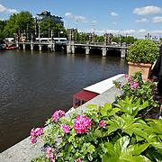 NLD/Amsterdam/20080520 - Uitzicht over de Anstel vanaf  het terras van het Amstel Hotel in Amsterdam