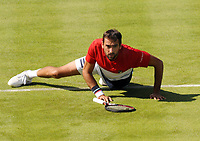 Tennis - 2018 Queen's Club Fever-Tree Championships - Day One, Monday<br /> <br /> Men's Singles, First Round: Marin Cilic (CRO) vs. Fernando Verdasco (ESP)<br /> <br /> Marin Cilic, slips on the grass on Centre Court.<br /> <br /> COLORSPORT/ANDREW COWIE