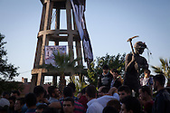 Demonstrators gather round a statue in Soma town, below the Soma mine in the nearby hills. Police fired tear gas and water canons to disperse the crowds.