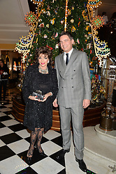 JOAN COLLINS and THOMAS KOCHS General Manager of Claridge's at the Claridge's Christmas Tree By Dolce & Gabbana Launch Party held at Claridge's, Brook Street, London on 26th November 2013.