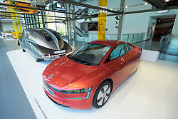 Volkswagen XL1 with very low drag on display at museum at Volkswagen's Autostadt in Wolfsburg , Germany