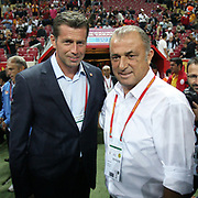Galatasaray's coach Fatih TERIM (R) and Eskisehirspor's coach Michael Heinz SKIBBE (L) during their Turkish Super League soccer match Galatasaray between Eskisehirspor at the TT Arena at Seyrantepe in Istanbul Turkey on Monday, 26 September 2011. Photo by TURKPIX