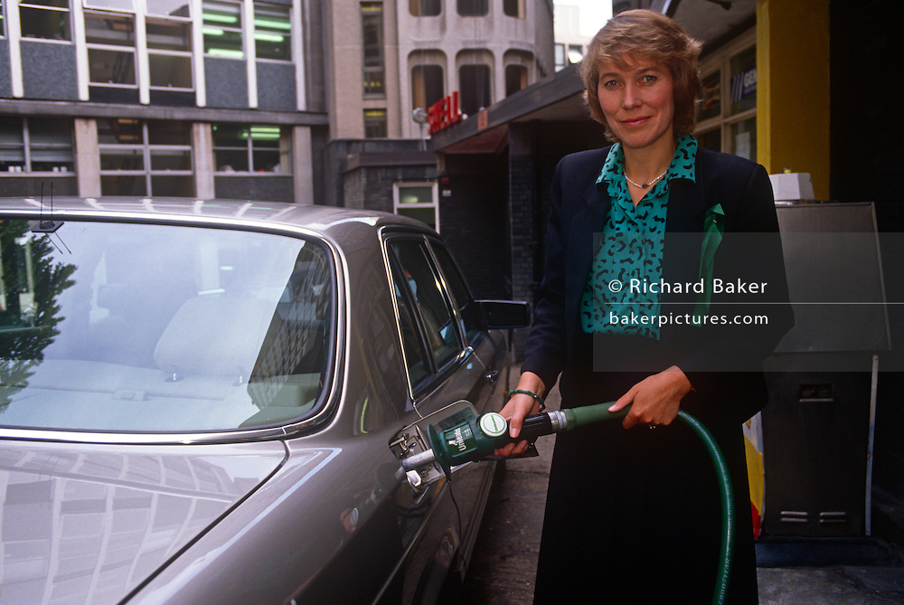 Conservative MP, Virginia Bottomley fills a car with unleaded fuel during Lead free Petrol Week in September 1989, London England. Virginia Hilda Brunette Maxwell Bottomley, Baroness Bottomley of Nettlestone, PC, DL (née Garnett, 1948) is a British Conservative Party politician. She was a Member of Parliament (MP) in the House of Commons from 1984 to 2005 and raised to the peerage in 2005.