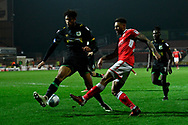 Kaiyne Woolery (22) of Swindon Town crosses the ball past Omar Sowunmi (17) of Yeovil Town to set up a chance during the EFL Sky Bet League 2 match between Swindon Town and Yeovil Town at the County Ground, Swindon, England on 10 April 2018. Picture by Graham Hunt.