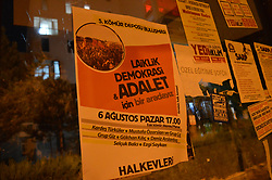 July 31, 2017 - Ankara, Turkey - A poster (L) that reads 'We gather for secularism, democracy and justice' in Turkish is seen posted on a window of a bus station in Ankara, Turkey on July 31, 2017. Turkey's opposition not affiliated with any political parties prepares to gather at the old coal yard on August 06, as they are going to mark the value of secularism, democracy and justice with a public concert. (Credit Image: © Altan Gocher/NurPhoto via ZUMA Press)