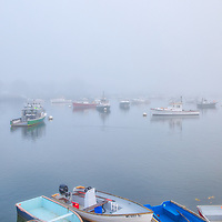 Massachusetts harbor fine art photography of Marshfield Green harbor with its fishing boats and dinghies under a blanket of fog. The fog beautifully created a serene harbor scenery.<br /> <br /> Massachusetts blanket of fog fine art photography image artwork of Marshfield Green Harbor is available as museum quality photography prints, canvas prints, acrylic prints, wood prints or metal prints. Prints may be framed and matted to the individual liking and decorating needs: <br /> <br /> https://juergen-roth.pixels.com/featured/fishing-boats-at-marshfield-green-harbor-juergen-roth.html<br /> <br /> Good light and happy photo making!<br /> <br /> My best,<br /> <br /> Juergen