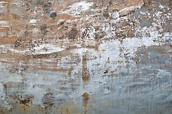 Abstract  of a rusting oil tank