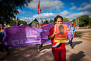 2014/11/25 – Monte Quemado, Argentina: A girl holds a poster with the image of Cristian Ferreyra, during the march of members of the National Movement of Indigenous Farmers (MOCASE), on the way to the court during the trial regarding the assassination of one on the Movement members, Cristian Ferreyra.  MOCASE fights against the rights of indigenous people and non occupation of forest by soy producers. Cristian Ferreyra was assassinated on the 16th of November 2011. Businessman Jorge Ciccioli, accused of being the mastermind of the assassination was at the end absolved of any crime, while his keeper, Javier Juárez, who pressed the trigger was sentanced to 10 years in prison. (Eduardo Leal)