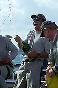 Ernesto Bertarelli sprays Moet and Chandon Champagne over his crew after Alinghi beats Oracle 5 - 1  in the finals. 19/1/2003  (© Chris Cameron 2003)