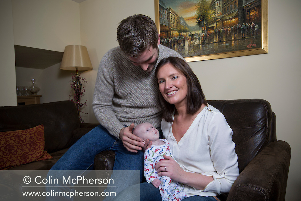 Philip and Kathryn Jones with their nine-week-old son Finn, at their home in Canterbury, Kent. Finn was born to parents Philip and Kathryn at Evelina London Children's Hospital with a pre-diagnosed condition which required a life-saving, five-hour heart 'switch' operation to be carried out within the first two weeks of his life. The operation, which took place when Finn was 10 days old was successful, however, due to other near fatal complications the his recovery during the subsequent six weeks was slow and difficult.