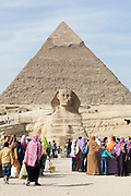 Tourists visit the Great Sphinx of Giza and the Pyramid of Khafre, Giza, Egypt