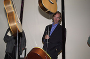 Mike Rutherford. The Craft of the Luthier. An exhibition of British handmade guitars. Linley. 25 April 2001. © Copyright Photograph by Dafydd Jones 66 Stockwell Park Rd. London SW9 0DA Tel 020 7733 0108 www.dafjones.com