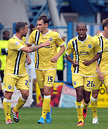 Ed Upson(center) of Millwall is congratulated on his equaliser against Huddersfield during the Sky Bet Championship match at the John Smiths Stadium, Huddersfield<br /> Picture by Graham Crowther/Focus Images Ltd +44 7763 140036<br /> 27/09/2014