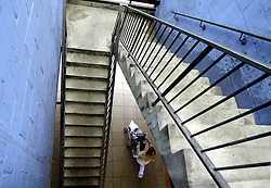 © Licensed to London News Pictures 04/05/2004.A mother walks under a stair well in Craylands estate, an impoverished council estate in Basildon, Essex..Basildon, UK.Photo credit: Anna Branthwaite