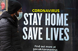 © Licensed to London News Pictures 02/03/2021.        Bexleyheath, UK. Government coronavirus advertising. People out and about in Bexleyheath, South East London today during a third national coronavirus lockdown. Non-essential shops could open in weeks if the Covid-19 infection rate keeps dropping. Photo credit:Grant Falvey/LNP