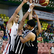 Efes Pilsen's Bostjan NACHBAR (L) and Besiktas's Engin ATSUR (R) during their Turkish Basketball league Play Off semi final first match Efes Pilsen between Besiktas at the Ayhan Sahenk Arena in Istanbul Turkey on Sunday 09 May 2010. Photo by Aykut AKICI/TURKPIX