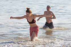 © Licensed to London News Pictures. 20/01/2019. Brighton, UK. Members of the public brave the cold water to have a swim in the Brighton and Hove sea as sunshine and mild weather hits the seaside resort. Photo credit: Hugo Michiels/LNP