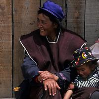 CHINA, TIBET. Menba Mother & child in Lunang Valley.