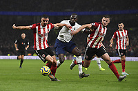 Football - 2019 / 2020 Premier League - Tottenham Hotspur vs. Sheffield United<br /> <br /> Tottenham Hotspur's Moussa Sissoko loses out to Sheffield United's Enda Stevens and Jack O'Connell, at Tottenham Hotspur Stadium.<br /> <br /> COLORSPORT/ASHLEY WESTERN