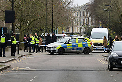 © Licensed to London News Pictures. 10/12/2020. London, UK. Staff and students of Stoke Newington School & Sixth Form in Hackney, north London, return back to the school after the school was evacuated following a bomb threat. Police were contacted by staff at 11.55am on Thursday after the school received a bomb threat. Pupils were evacuated and officers are at the scene. Photo credit: Dinendra Haria/LNP