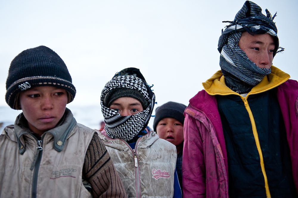 Village children bundled against the cold in Koh-e Kanak, a small enclave at the entrance to Band-e Amir National Park.