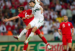John Terry of England plays with a hand vs Zlatan Ljubijankic of Slovenia during the 2010 FIFA World Cup South Africa Group C Third Round match between Slovenia and England on June 23, 2010 at Nelson Mandela Bay Stadium, Port Elizabeth, South Africa.  (Photo by Vid Ponikvar / Sportida)