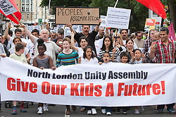 "© Licensed to London News Pictures. 13/08/2011. London, UK. People march through London. The ""give our kids a future"" march was called by the North London Assembly, a temporary assembly in reaction to the riots in Tottenham and Hackney. It included many Turkish and Kurdish groups. Photo credit: Bettina Strenske/LNP"
