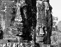Two Huge smiling stone faces of the bodhisattva Avalokiteshvara at The Bayon temple in the walled city of Angkor Thom, Siem Reap, Cambodia
