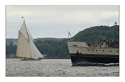 The Lady Anne, a 15 metre (95') Gaff Cutter built in 1912 passing the Waverley off Rothesay...This the largest gathering of classic yachts designed by William Fife returned to their birth place on the Clyde to participate in the 2nd Fife Regatta. 22 Yachts from around the world participated in the event which honoured the skills of Yacht Designer Wm Fife, and his yard in Fairlie, Scotland...FAO Picture Desk..Marc Turner / PFM Pictures