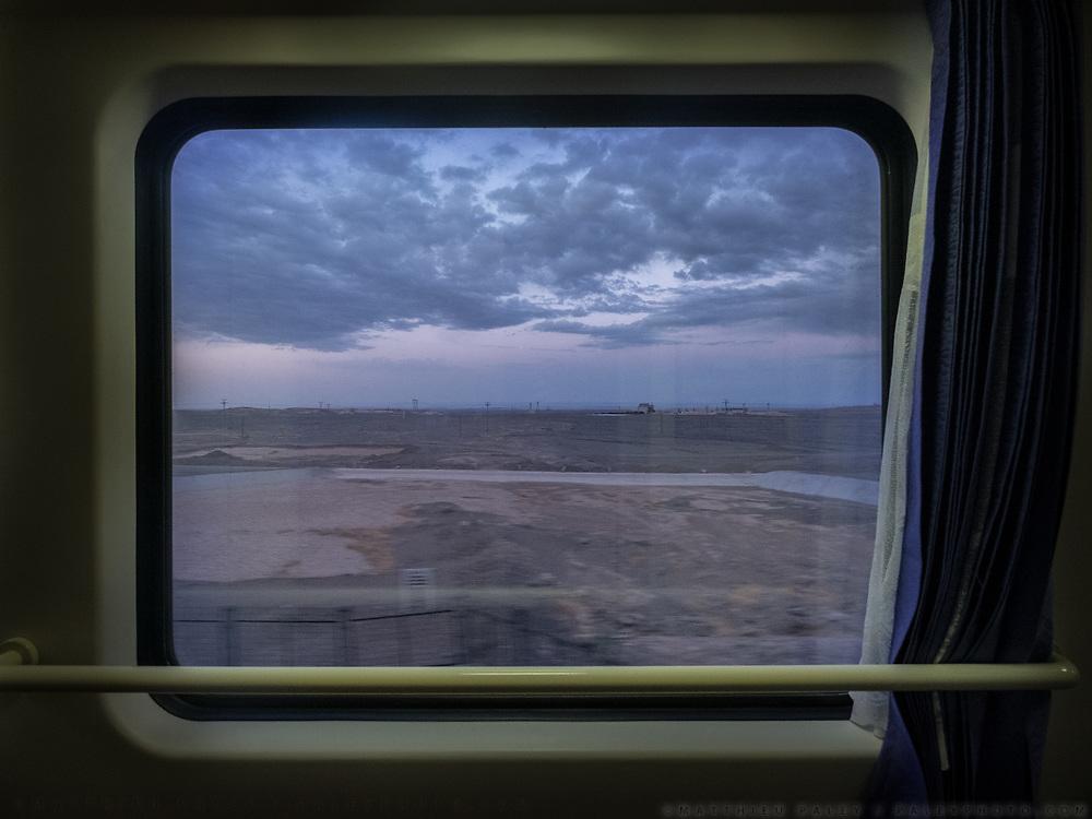 Window view across China, from the train from Guangzhou/Shenzhen to Xinjiang.