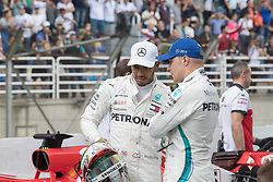 November 10, 2018 - Sao Paulo, Sao Paulo, Brazil - LEWIS HAMILTON (L) and VALTERI BOTTAS,  after the qualifying session to the Formula One GP Brazil 2018 at Interlagos circuit, in Sao Paulo, Brazil. The grand prix will be celebrated next Sunday, November 11. (Credit Image: © Paulo LopesZUMA Wire)
