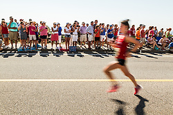 runners on Grand Avenue with only 200 meters downhill to the finish get lots of supports from a large crowd of spectators