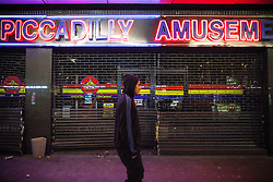 © Licensed to London News Pictures . 09/08/2011 . Manchester , UK . Piccadilly Amusements is looted , as disorder spreads to Manchester during a 4th night of rioting and looting , following a protest against the police shooting of Mark Duggan in Tottenham . Photo credit : Joel Goodman/LNP