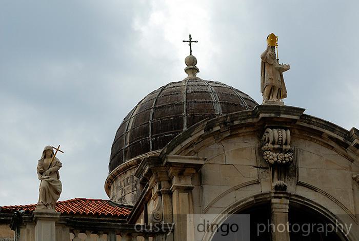 Statue representing Faith (left) and Saint Blaise (Sveti Vlaho), atop the church of Saint Blaise, Dubrovnik old town, Croatia